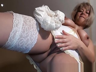 Mature English Amateur in Girdle & Stockings strips and plays
