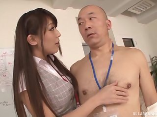 Slender Japanese babe in a tight skirt Kashii Ria gets cum on her tits