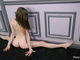Russian babe Klara Lookova does the splits and shows off yummy pussy in all its glory