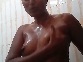 Torrid amateur topless nympho plays with her lubed small tits