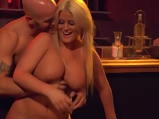 Julie Cash makes out with younger stranger in the bar
