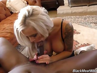 Astonishing blonde milf, Nina Elle is wearing erotic lingerie while having sex with a black guy
